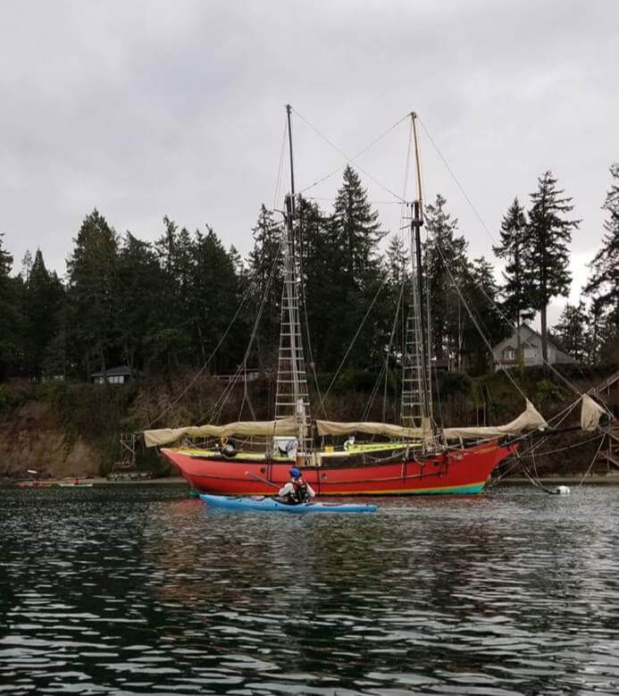 Robert Nissenbaum in a Point 65 N Whsikey 16 checking out an old sailboat names the H2O On the Water checking out the Pterodactyl