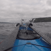 Spray over the bow - launching from Owen Beach on Point Defiance for leg 3 of the H2O Project