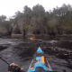 Stories: Sea kayaking off Cape Flattery. Heading out of a cave into the rocks - Sea kayaking to Neah Bay from the Pacific Ocean