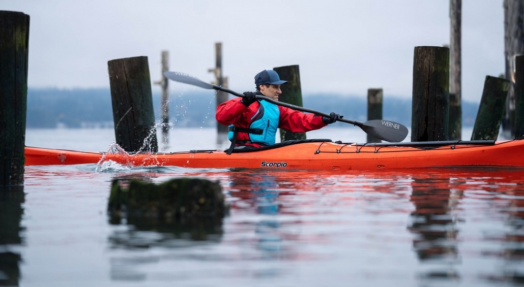 Robert Nissenbaum in a P&H Scorpio in the pilings off Titlow Beach Tacoma for an NRS photshoot
