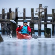 Robert Nissenbaum's NRS photshoot featuring the P&H Scorpio in the pilings off Titlow Beach Tacoma