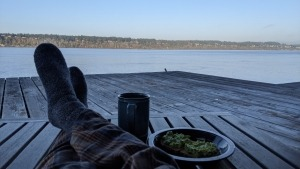 COVID-19 self quarantine - Day 4 picture of my feet on my deck with coffee and avocado toast
