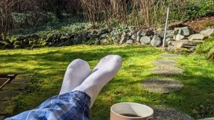 COVID-19 self quarantine - Day 5 picture of my feet and coffee on my girlfriend's deck in the woods