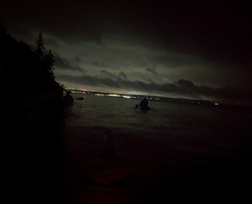 kayakers in the dark on a Biolume paddle Sept 2020 off Fox Island