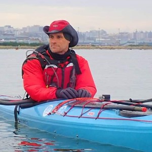 Robert Nissenbaum sitting in his Point 65N Whisky sea kayak off Jetty Island - a break from teaching an ACA forward stroke lesson for the North Sound Sea Kayaking Association (NSSKA)
