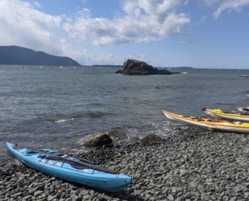 Sea kayaks on the beach near Carter Point during a circumnavigation of Lummi Island
