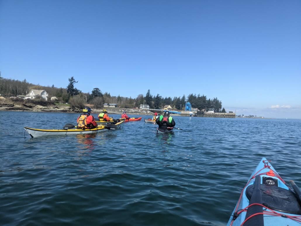Sea kayakers approaching the Lummi Island ferry dock