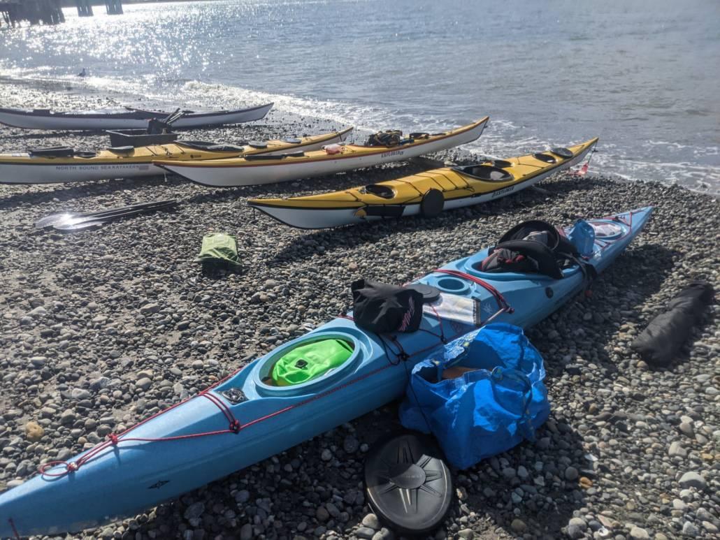 Sea kayaks on the beach at Gooseberry point