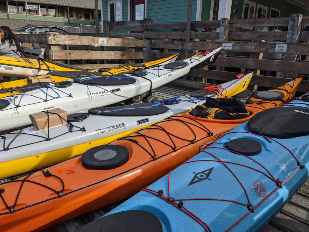 Sea kayaks side by side waiting to board the ferry