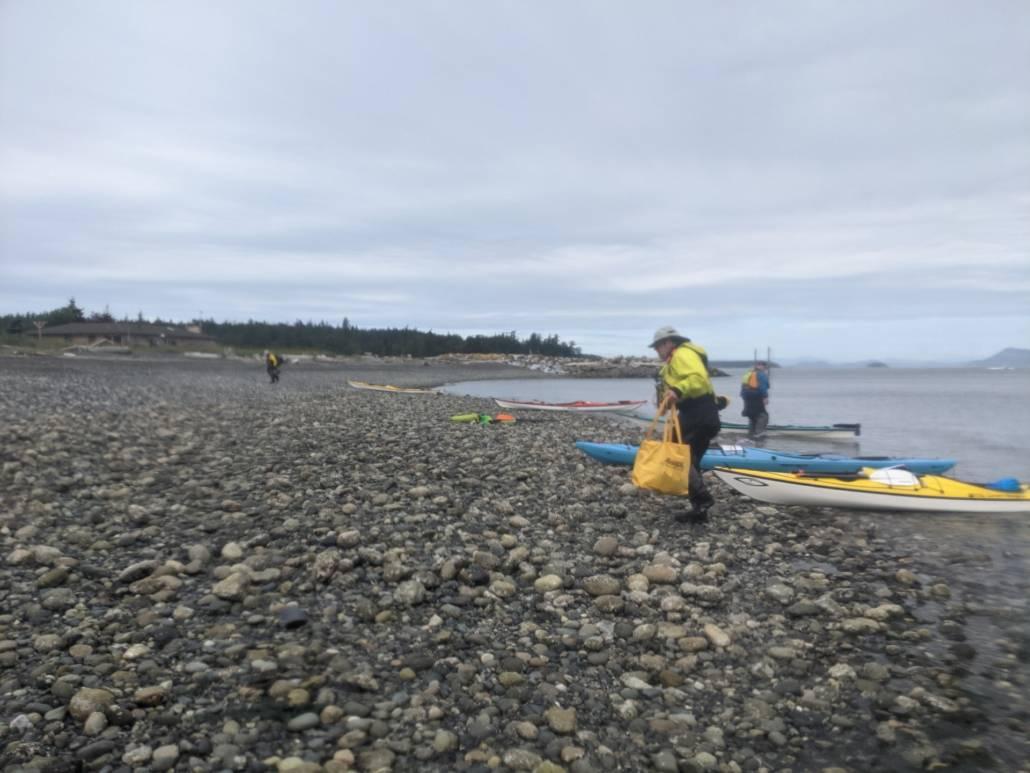 Unloading sea kayak on a rocky Orcas Island beach