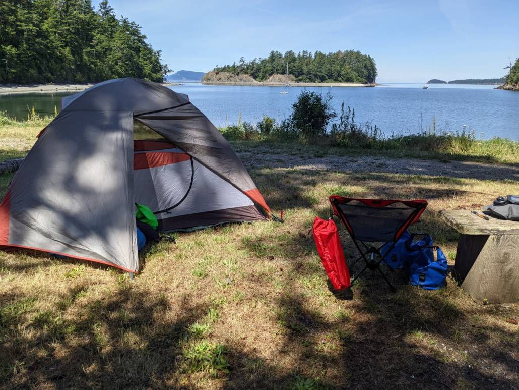 Tent on the grass looking out toward Fox Cove on Sucia