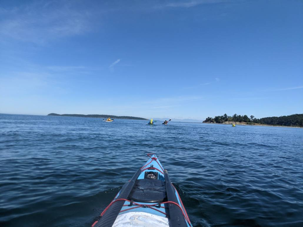 Heading to Sucia in a sea kayak under sunny skies