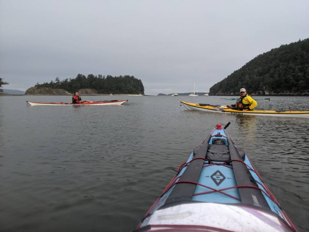 Sea kayakers eaving Sucia