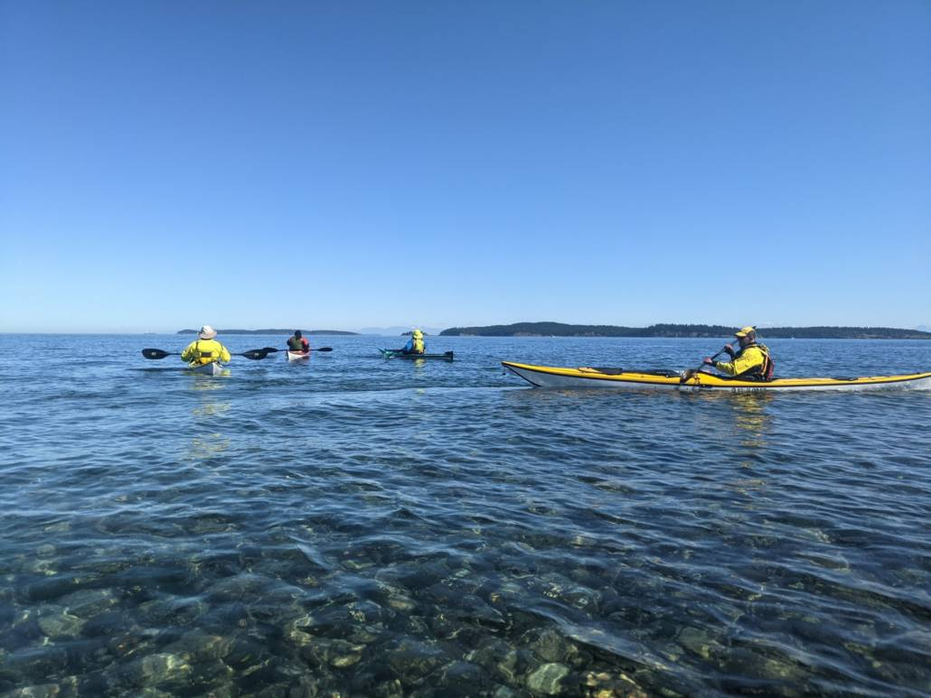 Launching our sea kayaks off North Beach on Orcas Island, heading to Sucia
