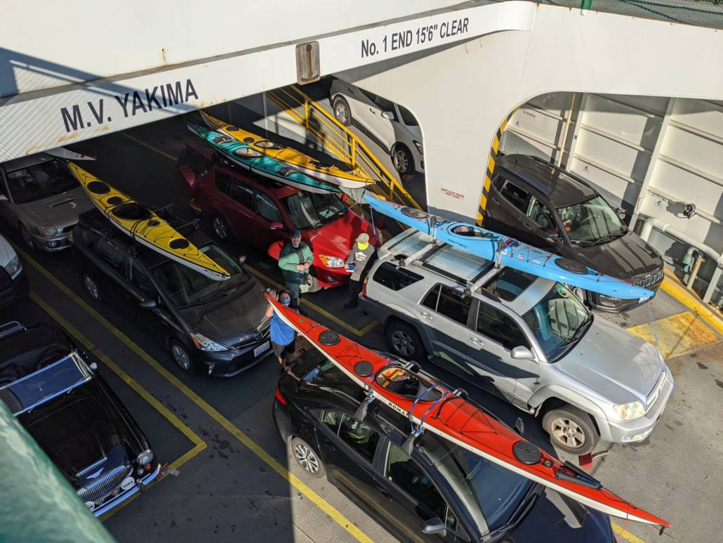Sea kayaks on our vehicles on he ferry to Orcas Island for the Sucia and Patos trip