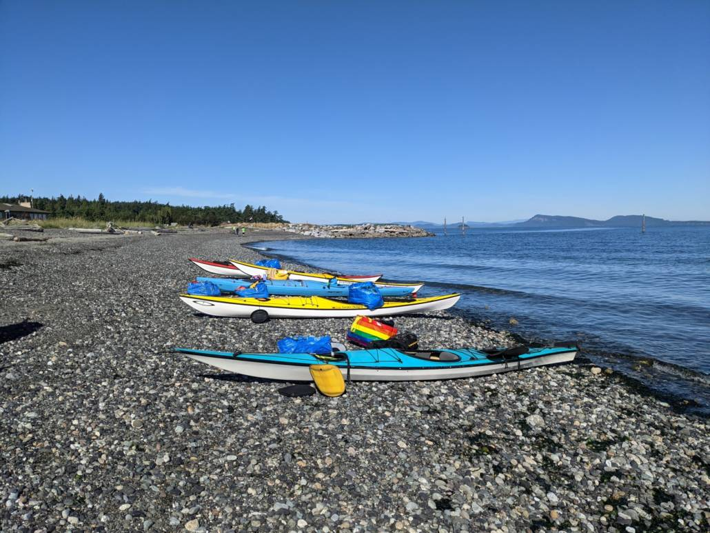 Sea kayaks on Orcas being packed for the crossing to Sucia Island