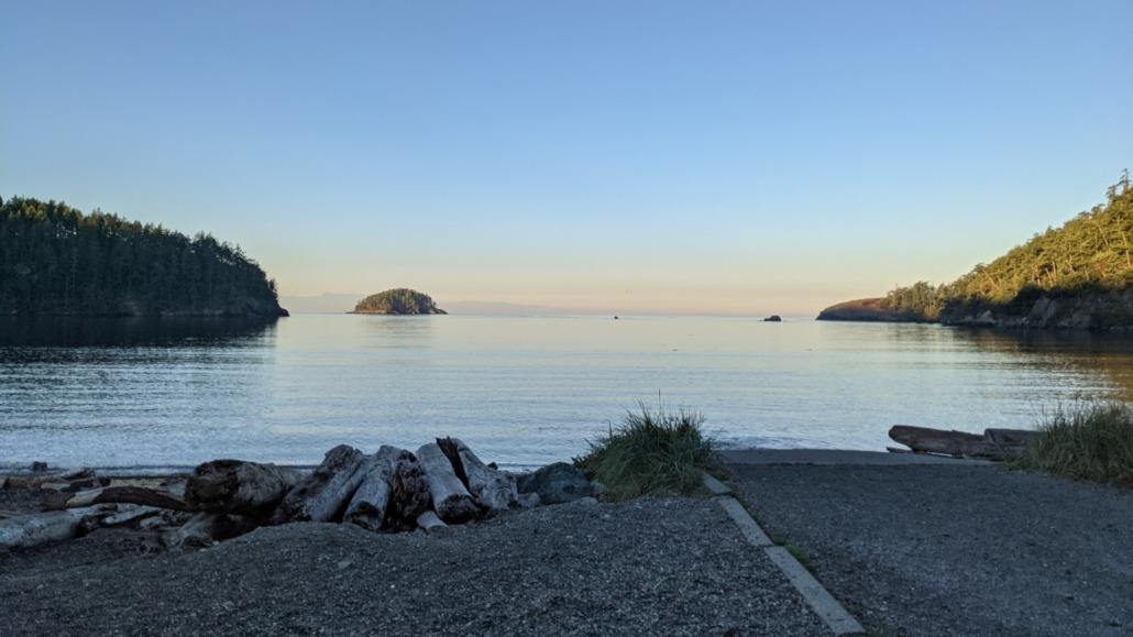 Bowman Bay, WA at sunrise looking toward Deception Island past flat water